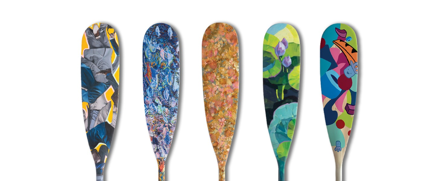 painted canoe paddles on display